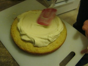 Place frosting in the middle of the cake and spread outward with a circular motion.
